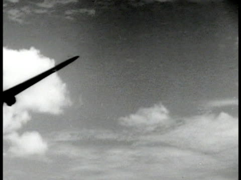 stockvideo's en b-roll-footage met skytrain airplane taking off c47 flying off into distance over mountains aerial ms nose of c47 inflight overhead clouds forests cu pilot in cockpit... - 1943