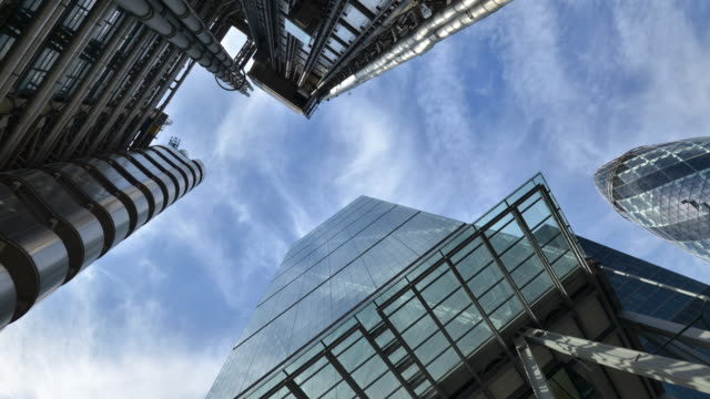 skyward view of buildings in the city of london - low angle view stock videos & royalty-free footage