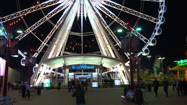 skywheel entrance at night. the famous ride is located at niagara falls city - event stock videos & royalty-free footage