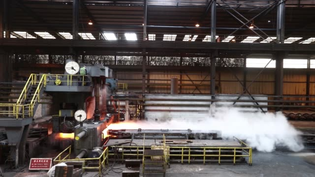 A slab of steel is sprayed with water on the descaler inside Liberty House Groups rolling steel mill in Newport UK on Tuesday May 17 2016