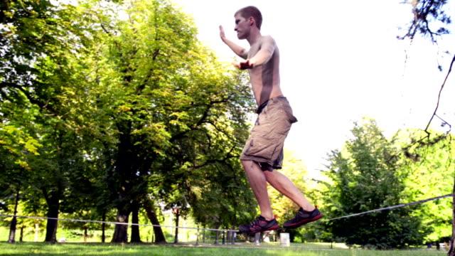 slacklining - tightrope walking stock videos & royalty-free footage