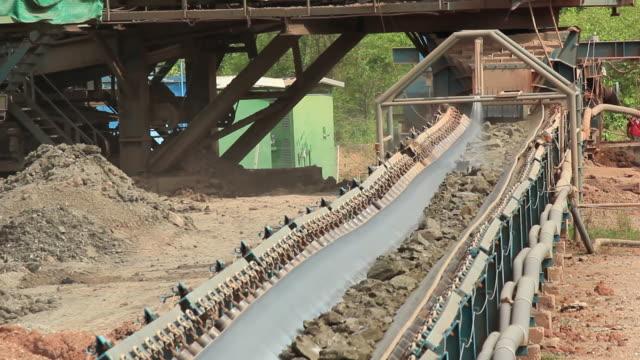 slag conveyor. - conveyor belt stock videos & royalty-free footage