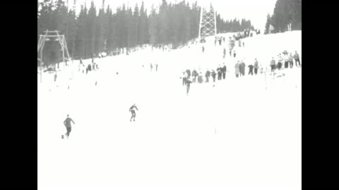 slalom course as skier speeds down, spectators and trees to sides / following skier speeding down slope / looking down on course as skier races down... - bobsledding stock videos & royalty-free footage
