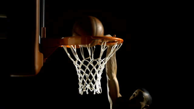slam dunk with one hand (super slow motion) - shooting baskets stock videos and b-roll footage