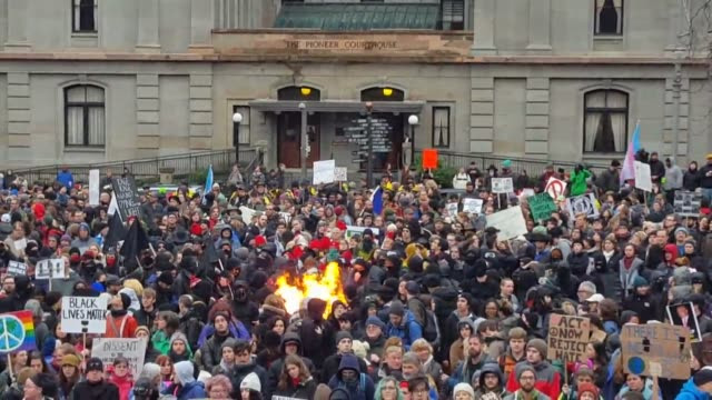slam poetry being spoken at the antifascism protest and anarchists burn flags close ups of signs at the antifascism rally at pioneer square - pioneer square portland stock videos & royalty-free footage