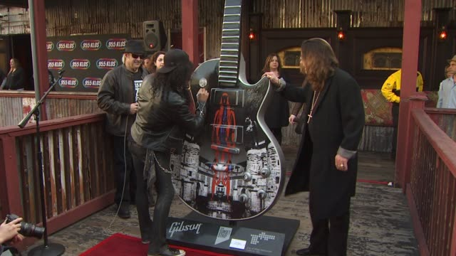 Slash and Ozzy Osbourne at the Ozzy Osbourne Signs a 10Foot Guitar at The House Of Blues at Hollywood CA