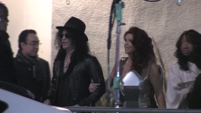 Slash Perla Ferrar arrive at the EMI Grammy after party in Hollywood 02/12/12