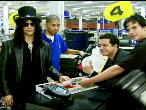 Slash with first game customers at the Best Buy Presents Guitar Hero® III Legends of Rock Launch Party at Best Buy Rooftop in Los Angeles California...