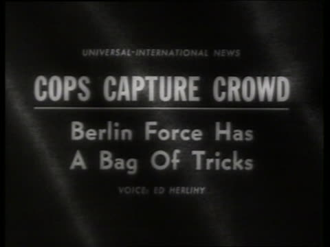 "Slate ""Cops Capture Crowd. Berlin Force Has a Bag..."""