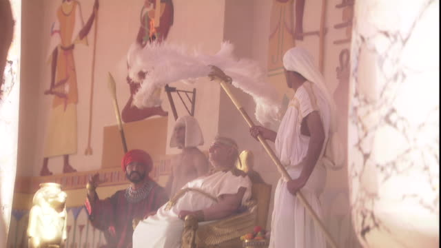 a slave fans the egyptian pharaoh as he sits on his throne. - pharaoh stock videos & royalty-free footage