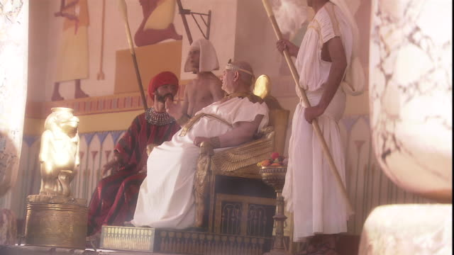 a slave fans the egyptian pharaoh as he sits on his throne. - throne stock videos & royalty-free footage