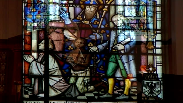 events mark 200th anniversary of its abolition wilberforce interview sot on people trafficking stained glass window in church featuring images of... - trafficking stock videos and b-roll footage
