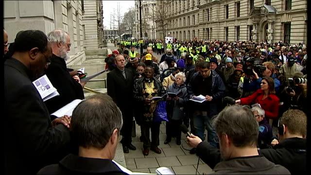 vídeos y material grabado en eventos de stock de london march to mark 200th anniversary of abolition of slavery marchers along england london ext rowan williams and john sentamu at head of march to... - blair williams