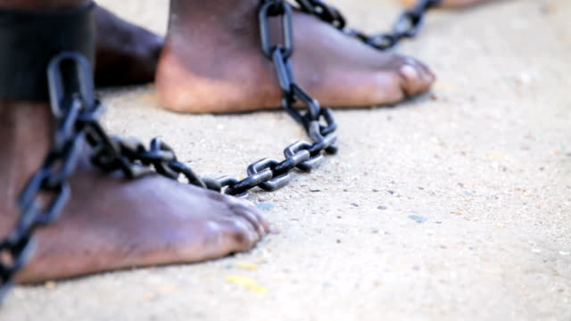slaves feet shackled together - trafficking stock videos and b-roll footage