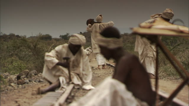 slaves work on a railroad in tanzania. - slavery stock videos & royalty-free footage