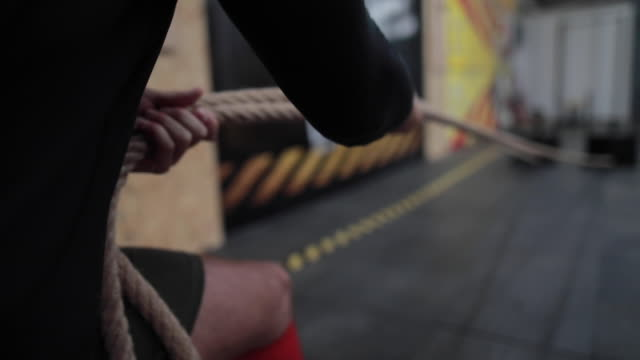 sled pull work out - sports training drill stock videos & royalty-free footage