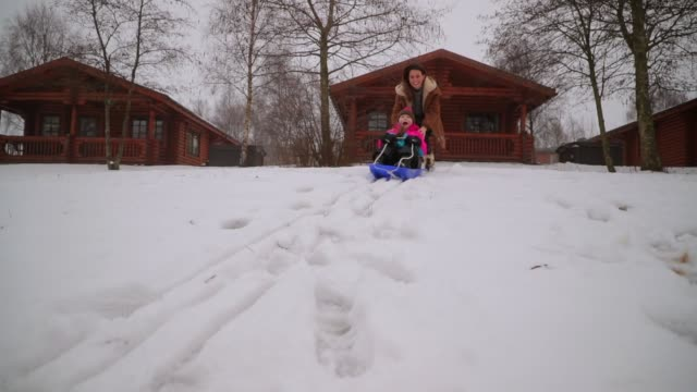 sledding with her mother - sledge stock videos & royalty-free footage