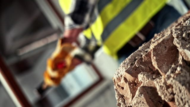 slo mo ld sledge hammer being used to break up masonry - construction industry stock videos & royalty-free footage