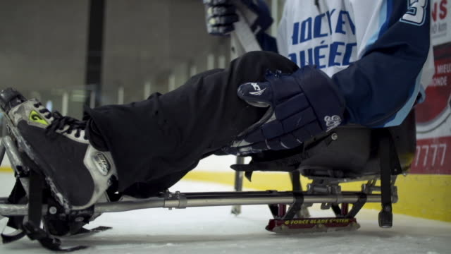 sledge hockey player getting on his sled (sled hockey) - hockey glove stock videos & royalty-free footage