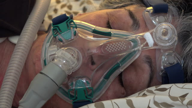sleep apnea, senior real people woman wearing a cpap mask while she sleeps - sleep apnea stock videos and b-roll footage