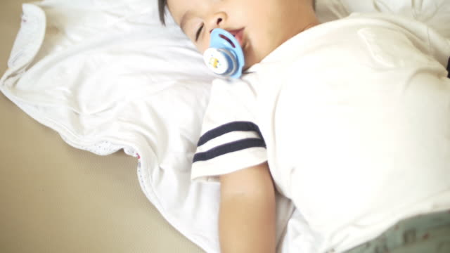 slo mo sleeping baby at home - one baby boy only stock videos & royalty-free footage