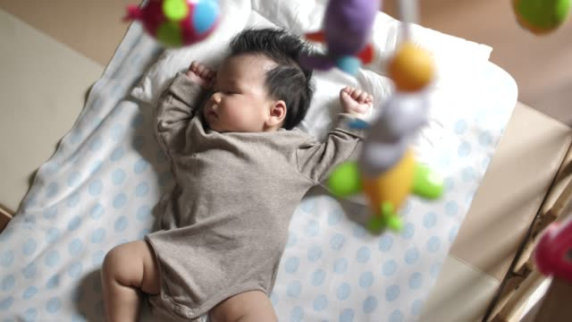 sleeping baby at home - sdraiato video stock e b–roll