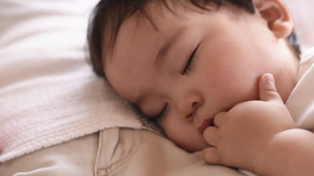 sleeping baby boy on grandmother - eyes closed stock videos & royalty-free footage
