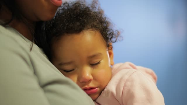 sleeping baby girl cuddling into her mother - carrying stock videos & royalty-free footage
