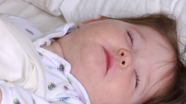 cu sleeping baby moving around and waking up/ vancouver, bc - see other clips from this shoot 1101 stock videos & royalty-free footage
