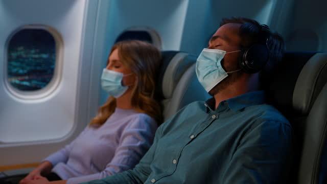 sova i flygplan - kupe bildbanksvideor och videomaterial från bakom kulisserna