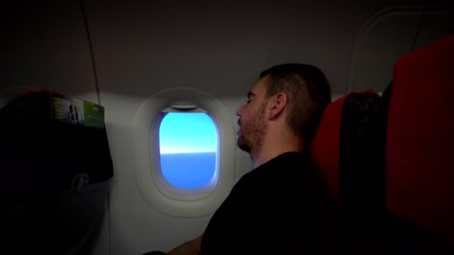 sleeping in the plane - snoring stock videos and b-roll footage