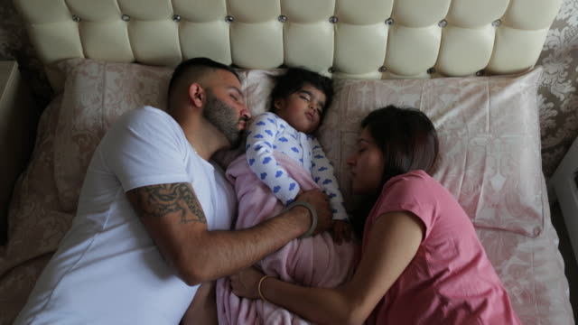 sleeping trio - babygro stock videos & royalty-free footage