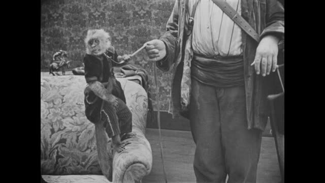 1918 sleeping woman scared by monkey in bedroom - fatty arbuckle stock videos and b-roll footage
