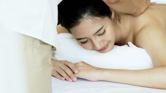 Sleeping women relax with a massage.