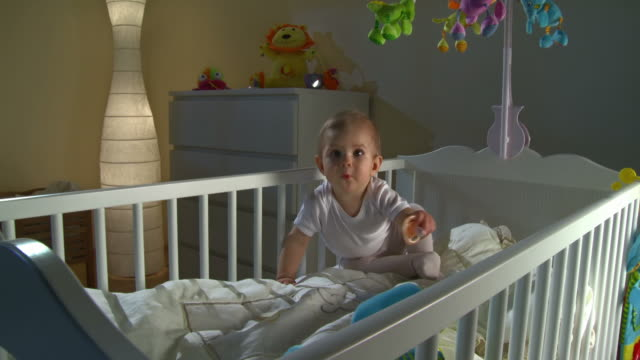 hd crane: sleepless baby playing with pacifier - babies only stock videos & royalty-free footage