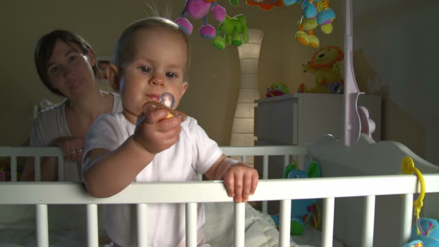 hd crane: sleepless baby with pacifier - pacifier stock videos and b-roll footage