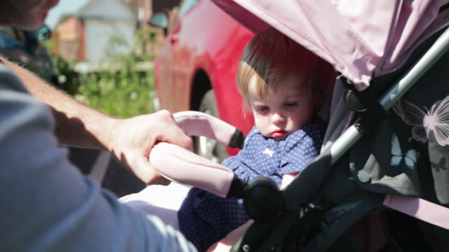 sleepy baby in buggy - role reversal stock videos & royalty-free footage