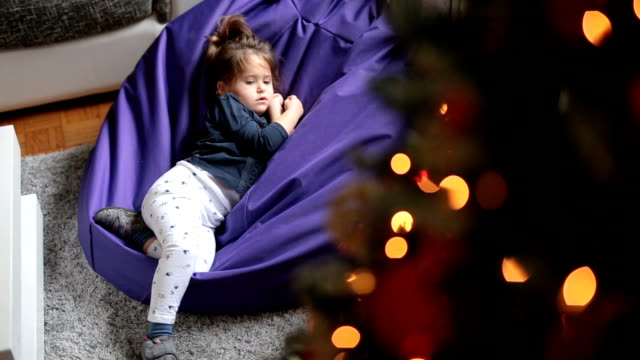 sleepy child on christmas - bean bag stock videos & royalty-free footage