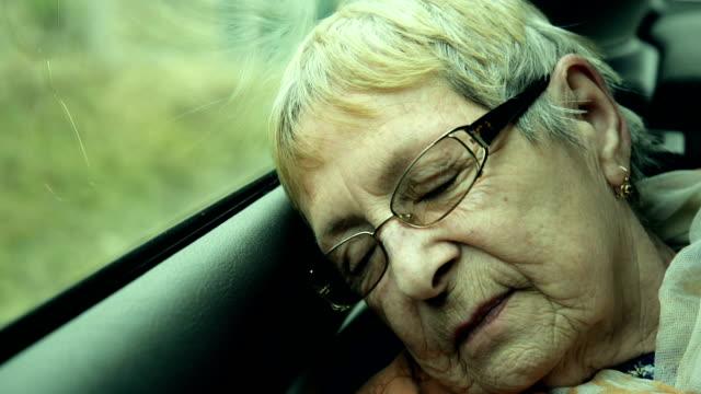 Sleepy elderly woman