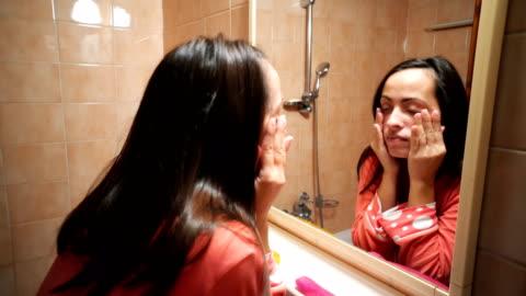 sleepy woman in the bathroom - mirror stock videos & royalty-free footage
