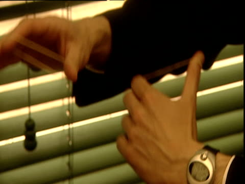sleight-of-hand magic trick with elastic bands - blinds stock videos & royalty-free footage