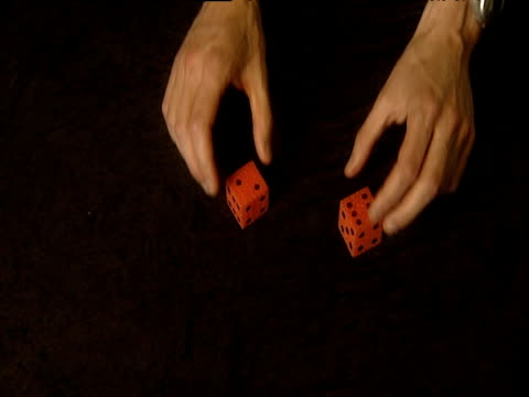 sleight-of-hand magic trick with foam rubber dice - foam hand stock videos and b-roll footage