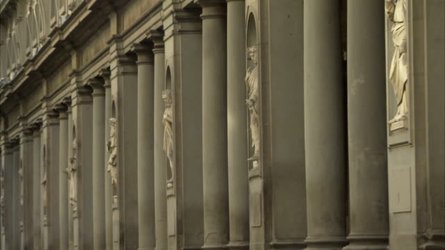 slender doric columns characterize a building in florence. available in hd. - doric stock videos & royalty-free footage