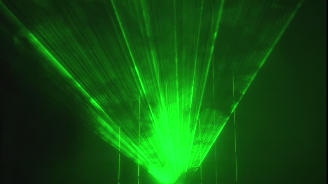 slender green beams of laser light radiate and rotate from a single point. - laser stock videos & royalty-free footage