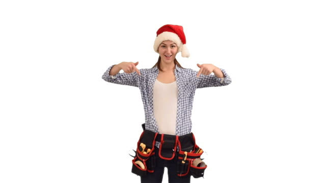 slender young woman construction worker in a cap of Santa Claus shows a copy space on a white background