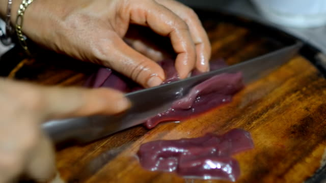 slice liver of swine - liver stock videos and b-roll footage