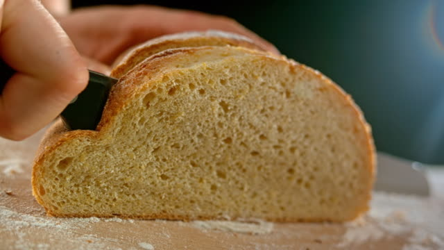 slo mo ld a slice of corn bread being cut - bread stock videos & royalty-free footage