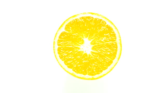 Slice of fresh orange isolated.