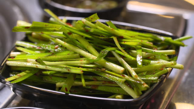 slice of green onions with pepper powder (korean food) - scallion stock videos & royalty-free footage