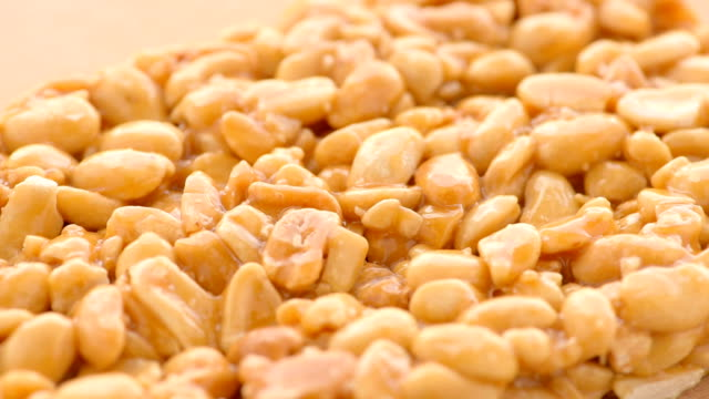 slice of kozinaki of peanut, close up - peanut food stock videos & royalty-free footage